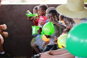 Volunteering at an African orphanage.