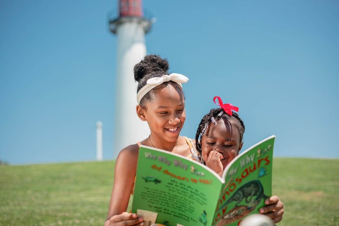 children reading from child learning resources